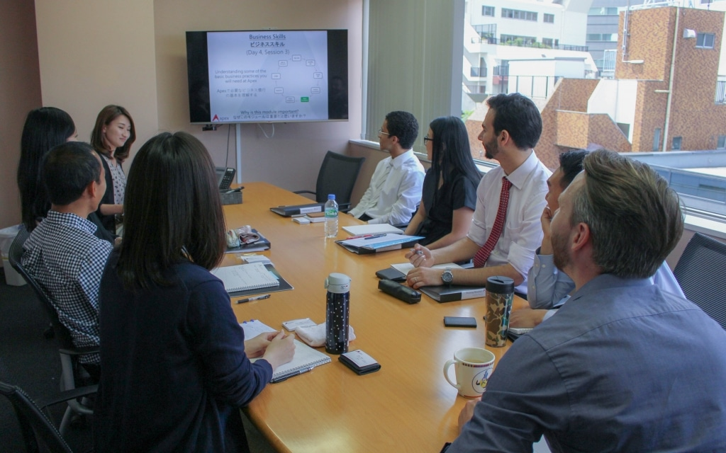 The new hires listen to a presentation on Japanese Business Skills