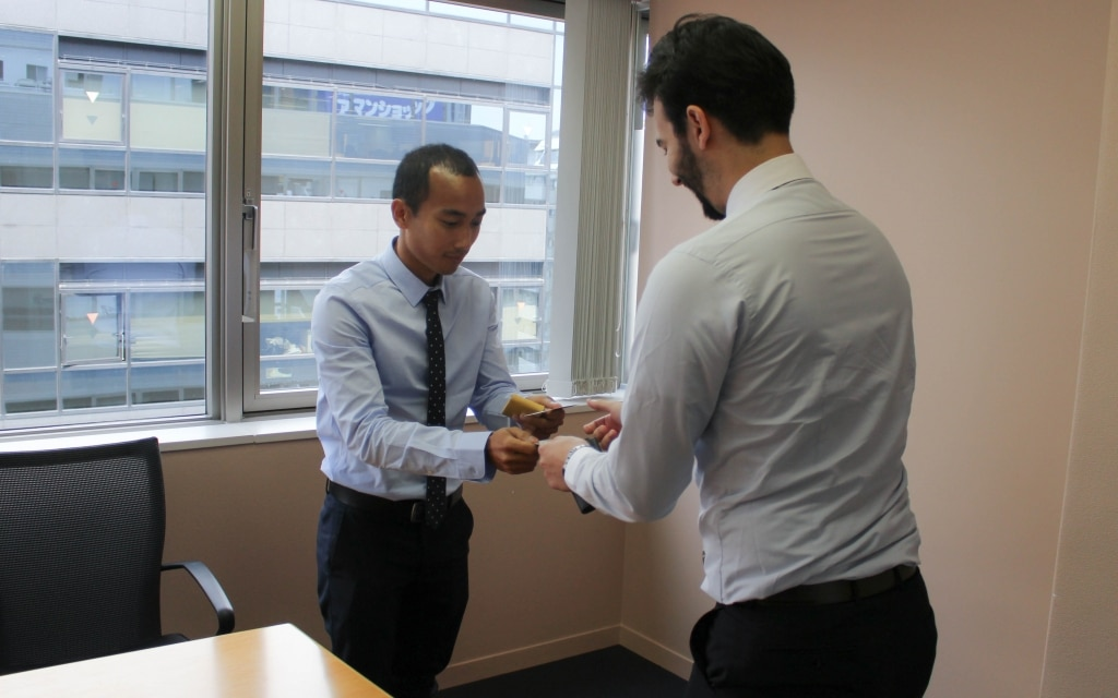 Two new hires practice exchange business cards