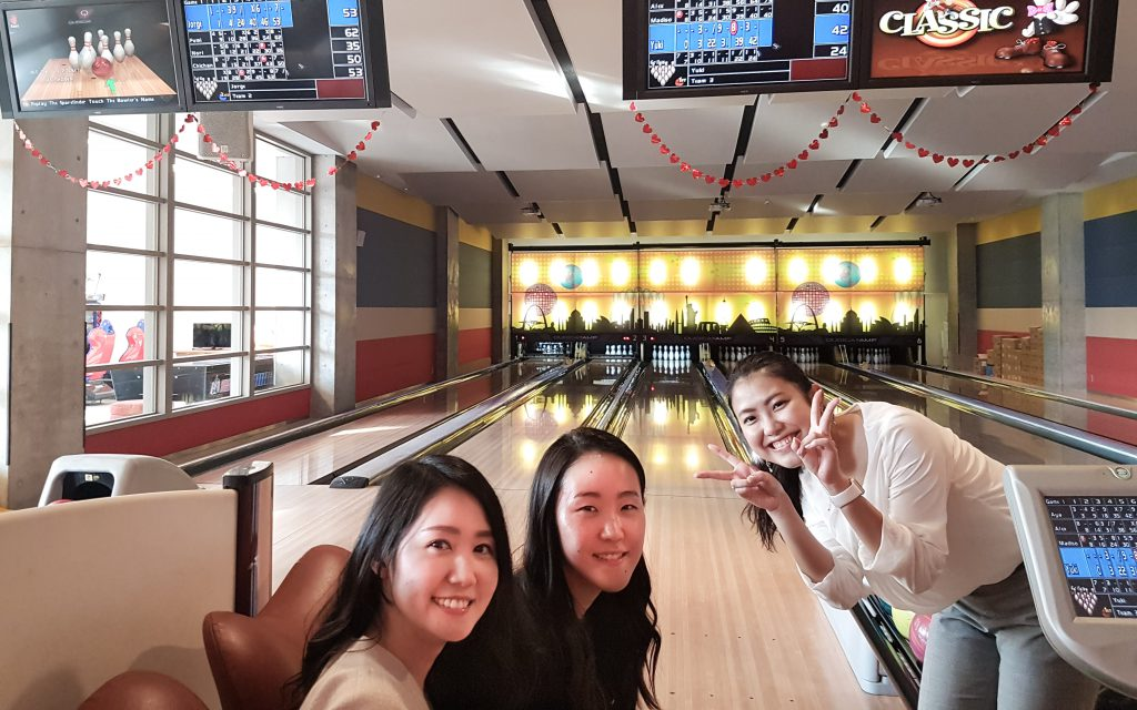 coworkers in bowling alley